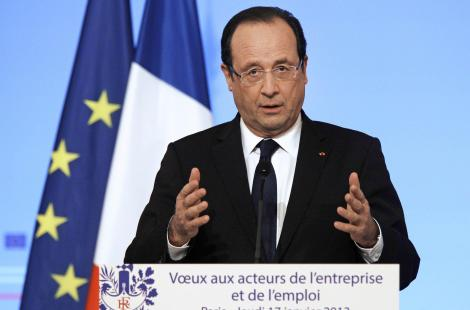 French President Francois Hollande leaves the stage after delivering his speech, during the New...