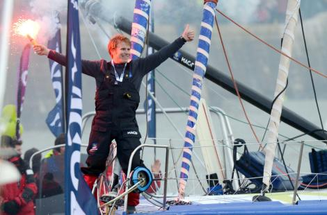 French skipper François Gabart celebrates on his boat after winning the 7th edition of the Vendee...
